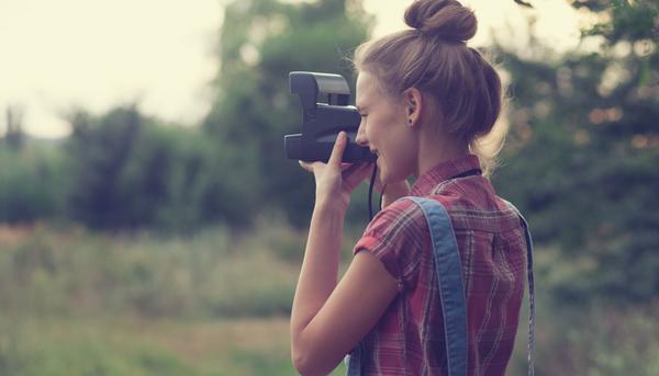 Girl photographer shooting outdoors